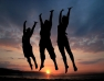 Three people jumping